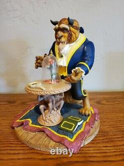 Disney Beauty and the Beast figurine of Beast with Rose. MINT Condition